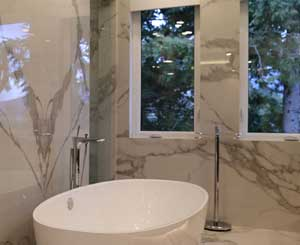 Private bathroom with stone walls and flooring