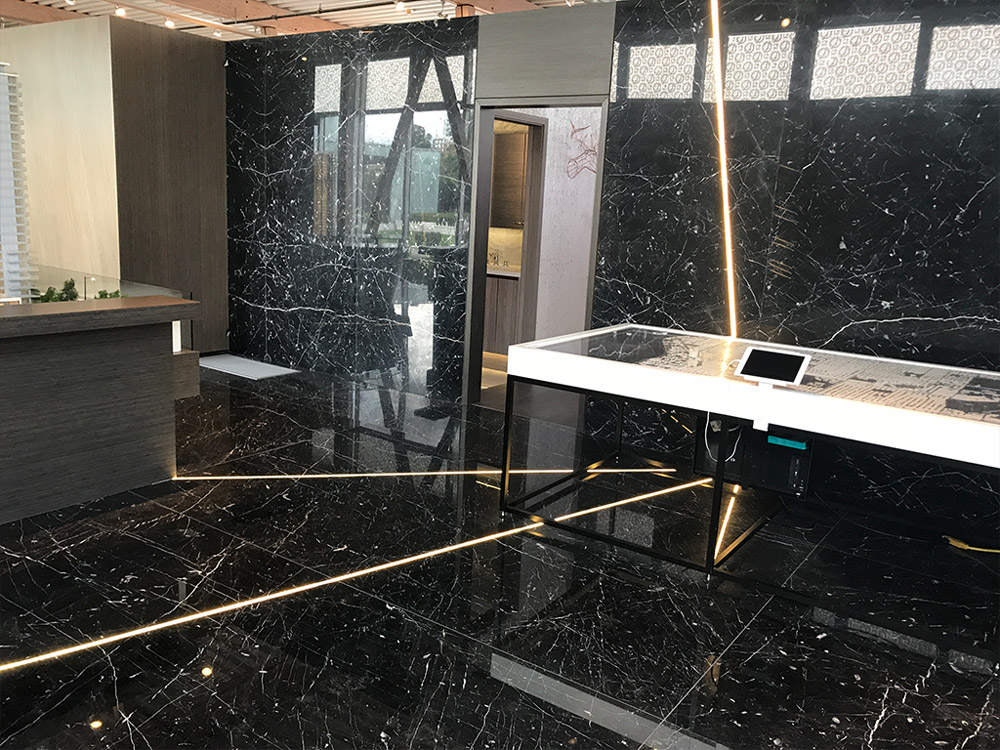Beautiful black stone flooring and walls for realty sales centre