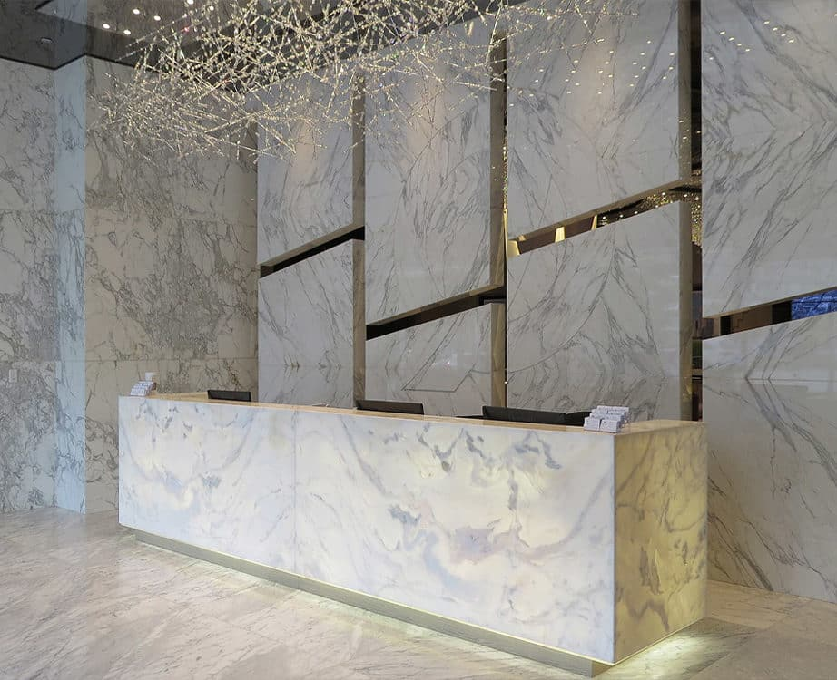 Large format manufactired stone in hotel entryway